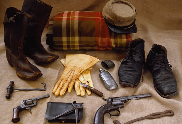 Civil War cavalryman gear includes boots, boot hook, spare shoes, kepi, gauntlets, pin-fire pistols, a hoof knife, a leather cartridge case for pistol, a pair of hoof trimmers and a horse shoeing hammer. (Photo Credit: Tria Giovan/CORBIS)