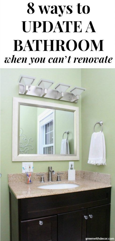 Easy ways to update a bathroom without renovating - if you can't afford a bathroom remodel or are renting, these are great tips for updating your bathroom! Update small things like towel hooks or towel bars, light fixtures, wall art and more!