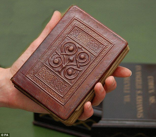 Europe's oldest book: the 7th century St Cuthbert's Gospel (a copy of the Gospel of St John), was buried with St. Cuthbert on the island of Lindisfarne (off the coast of Northumberland) in ca. AD 698.  His coffin was removed to Durham to preserve it from Viking raiders and the book was discovered when the coffin was opened at Durham Cathedral in AD 1104. This is the original red leather binding.