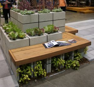 Cool Bench and planter http://sowswell.com/2012/08/21/ideas-and-inspiration-for-a-modern-vegetable-garden/