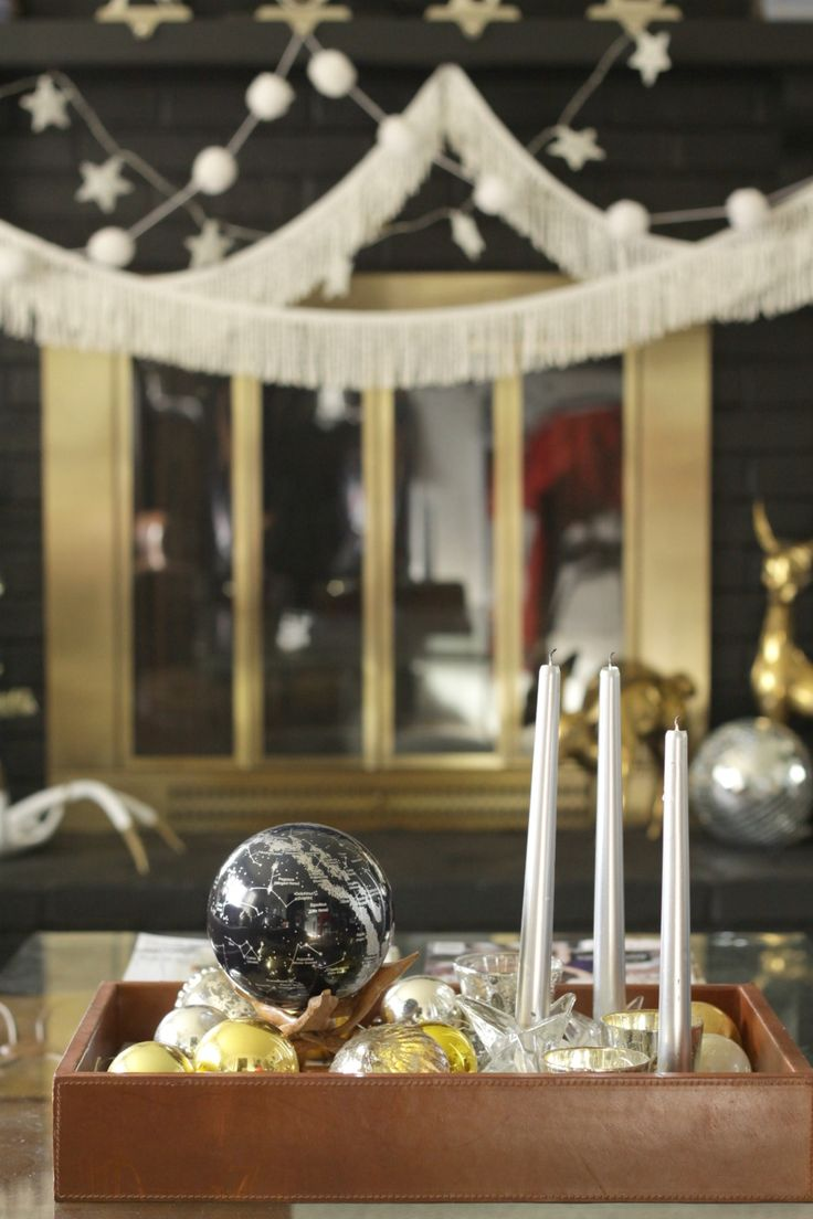 Coffee table decor featuring a Silver & Black Constellations MOVA Globe. Photo by Cassie Bustamante