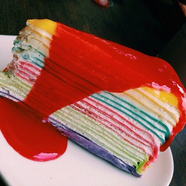 Rainbow crepe cake. FYI (An Unseelie King mini-spoiler) - This is the cake Minerva wishes for. The one provided by the Hollow Box. :)