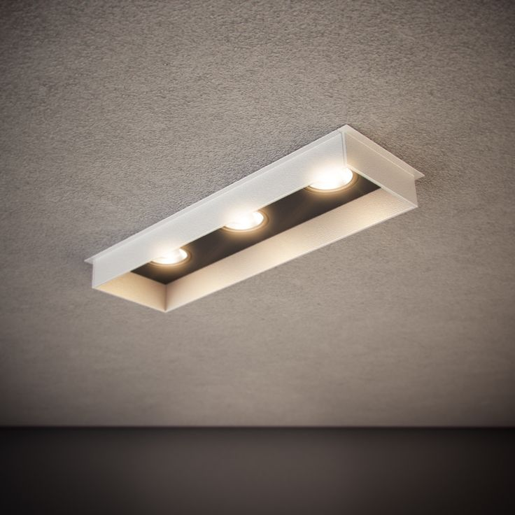 Triple Down SR is a semi-recessed luminaire with 30mm of exposed trim. The internal blind cover can be coloured to match its trim or in contrast as an architectural feature. Available in single, double, triple and quad configurations | http://www.darkon.com.au/product/triple-down-sr/