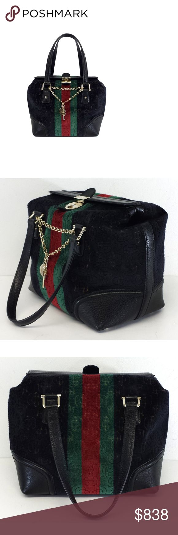 """Gucci- Treasure Small Boston Handbag Treasure Small Boston Handbag Black w/green & red stripes Horsebit embossed velvet Genuine leather Gold-tone hardware Metal studs across bottom Decorative chain w/key & engraved coin Comes w/original dust bag & extra key Made in Italy Flap over & push clasp close 1 inner zip pocket Double handles Width 8.5"""" Height 10"""" Depth 6.25"""" Handle drop 7"""" Gucci is an Italian brand specializing in high-end fashion and leather goods. Gucci offers classic, timeless…"""