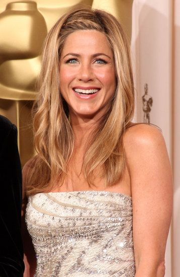 This braided style on Jennifer Aniston is a must-try for Spring. See all of her iconic hair moments here: