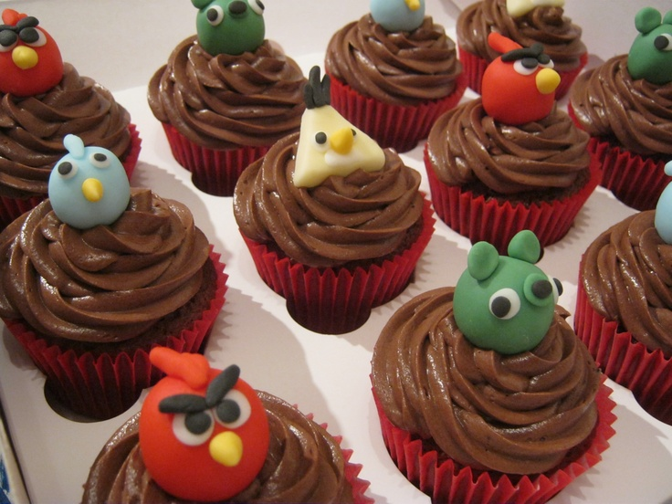 Tasty chocolate cupcakes topped with handmade Angry Birds toppers