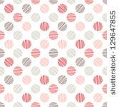 Seamless pattern. Stylish polka dot texture by Curly Pat, via ShutterStock