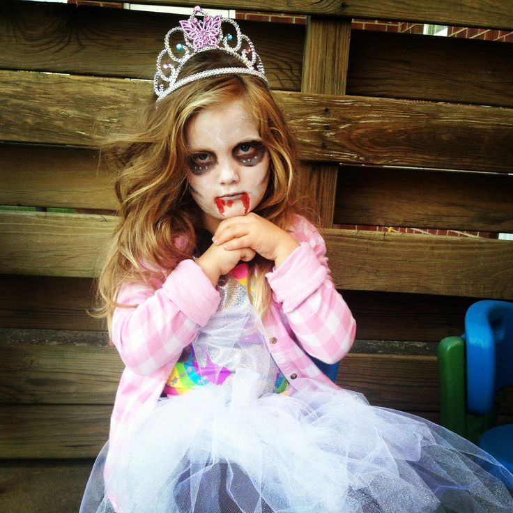 DIY zombie princess. Old shirts, $4 to make tutu Cheapest costume we've ever done :))