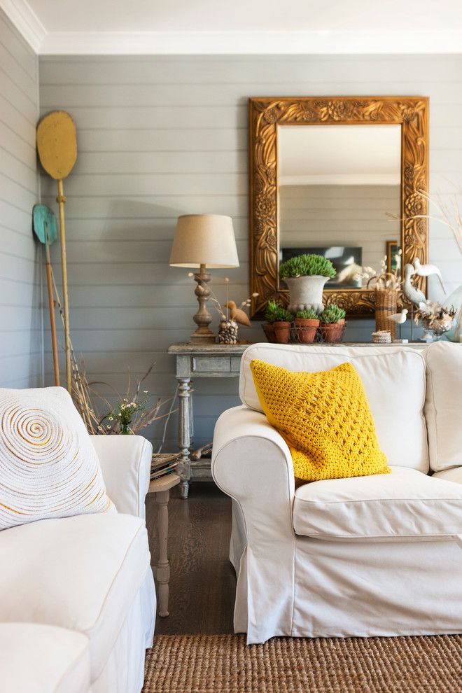 Stylish decor elements - yellow knitted cover for decorative pillows in the interior pastel