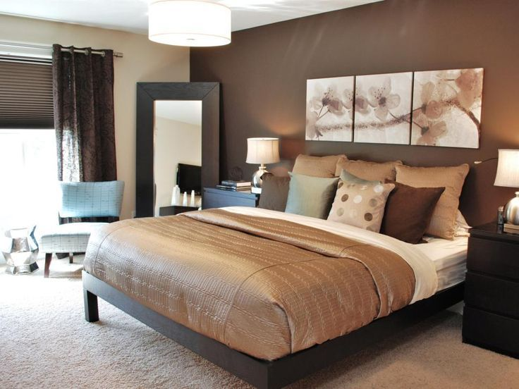 Designer Judith Balis combined various hues of tan and brown with soothing gold and copper accents throughout this modern bedroom retreat. A rich, chocolate brown accent wall complements the shimmery gold duvet and accent pillows for an ultra-relaxing feel.
