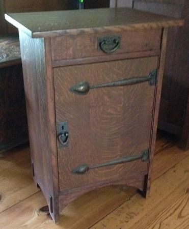 Gustav Stickley Cabinet featuring hammered copper strap hinges, sweeping arch to base, and sides with exposed thru tenons. A very rare form.