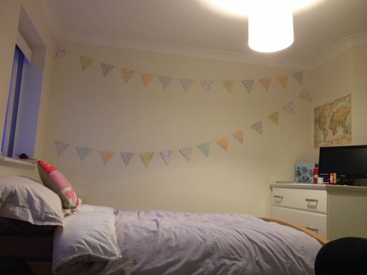DIY bunting - using scrapbooking paper and yarn. Just adds a bit of colour to an otherwise plain wall.