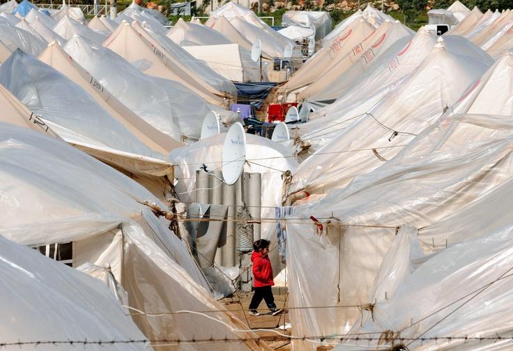Síria. Há sírios a viver há mais de ano e meio em campos de refugiados na Turquia. Ancara recebe-nos mas não os deixa trabalhar nem estudar GIANLUIGI GUERCIA/AFP