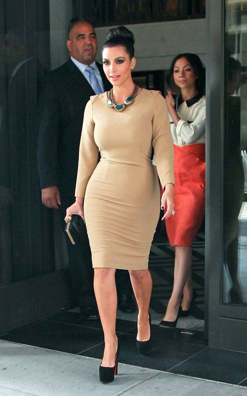 Kim Kardashian wearing Yves Saint Laurent Clutch Christian ...