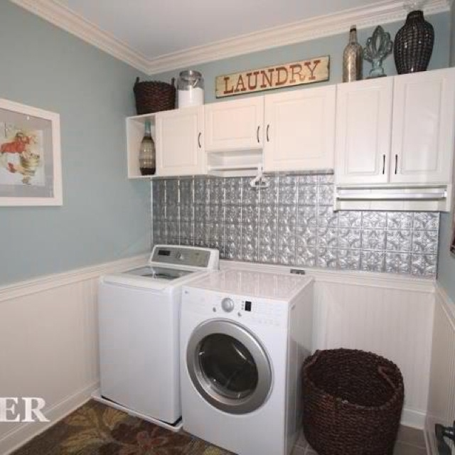 Shorter cabinet with hanging rod under laundry room for Laundry room cabinets