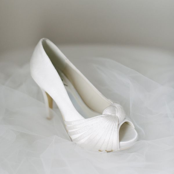 Satin Knot Peeptoe Wedding Shoes by Pearl & Ivory ®  - Find more elegant wedding shoes from our collection www.pearlandivory.com/bridal-shoes.html. Photography by Yolande Marx #PearlandIvory #Knot #WeddingShoes #SatinHeels #Peeptoe #BridalShoes