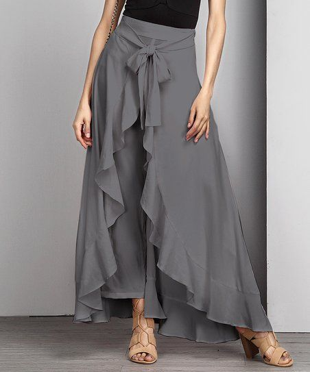 A tie-waist brings the focus to your curves with these style-forward palazzo pants, while an elegant ruffle-front adds feminine panache.Shipping note: This item is made to order. Allow extra time for your special find to ship.
