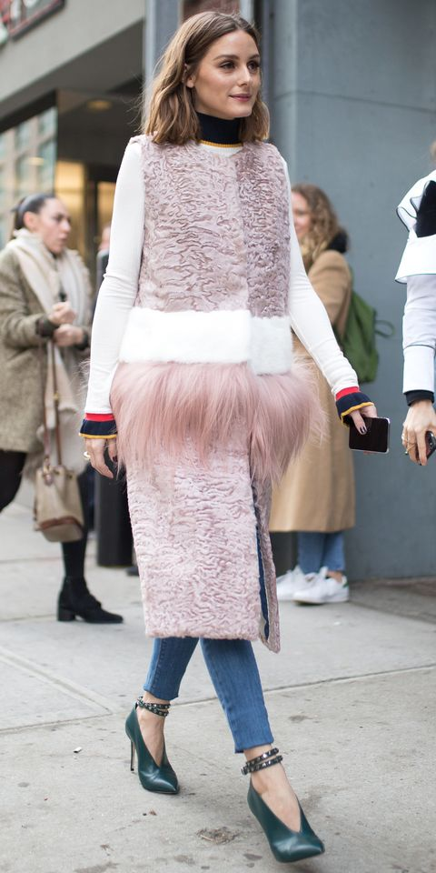 Olivia Palermo didn't let NYC's weird transitional weather stop her from looking chic at fashion week. A fur-lined vest by Cara Mila ($5,649; farfetch.com) protected her from chilly winds, but the sleeveless design also kept her arms free. A multi-color sweater, jeans, Jimmy Choo boots ($805; farfetch.com), and dainty jewelry topped off the look.