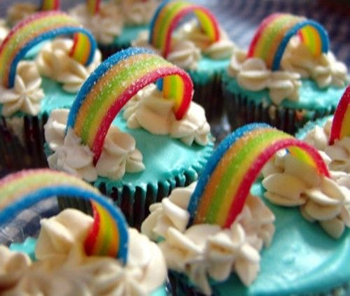 "rainbow cupcakes: rainbow chip cupcakes with blue frosting, white ""clouds,"" and Airhead Xtremes candy."
