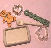 Miniature accessories.  Cookie sheet, cookie cutters, gingerbread, et al.  Sold in KITCHEN MINIATURES on website http://barbspencerdolls.com