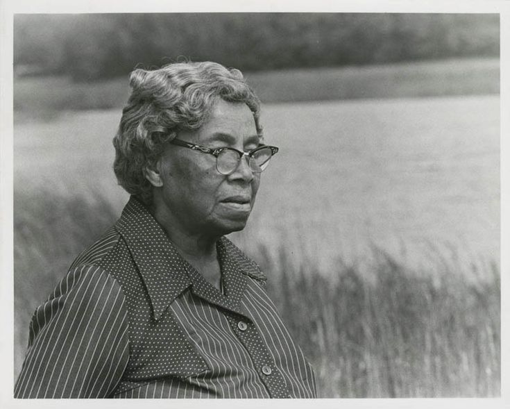 lowcountrydigitallibrary:    Septima P. Clark  Black and white photograph of Septima P. Clark standing by tall grass and a river during filming for television documentary about her.  Septima Poinsette Clark (1898-1987) was born in Charleston South Carolina to Peter Porcher Poinsette and Victoria Anderson. Clark attended small private schools and Avery Institute getting a teachers certificate in 1916. She married Nerie Clark (1889-1925) of North Carolina a navy cook in 1920; they had one…