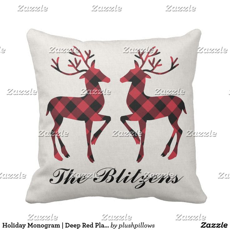 Holiday Monogram | Deep Red Plaid Reindeer Throw Pillow Seasonal Christmas throw pillow features custom black script monogram text and two festive reindeer with antlers in a red and black buffalo plaid pattern. The background is a light neutral color with subtle linen textured appearance. A buffalo check pattern dresses up the back of the pillow design.