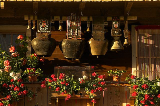 A typical Swiss balcony with geraniums and cow bells. Inner Eriz, Bernese Oberland, Switzerland  also seen in Germany