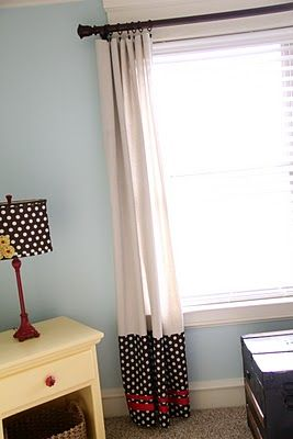I don't like the material, but I like the style.  Could you add onto shorter curtains with patterned material?