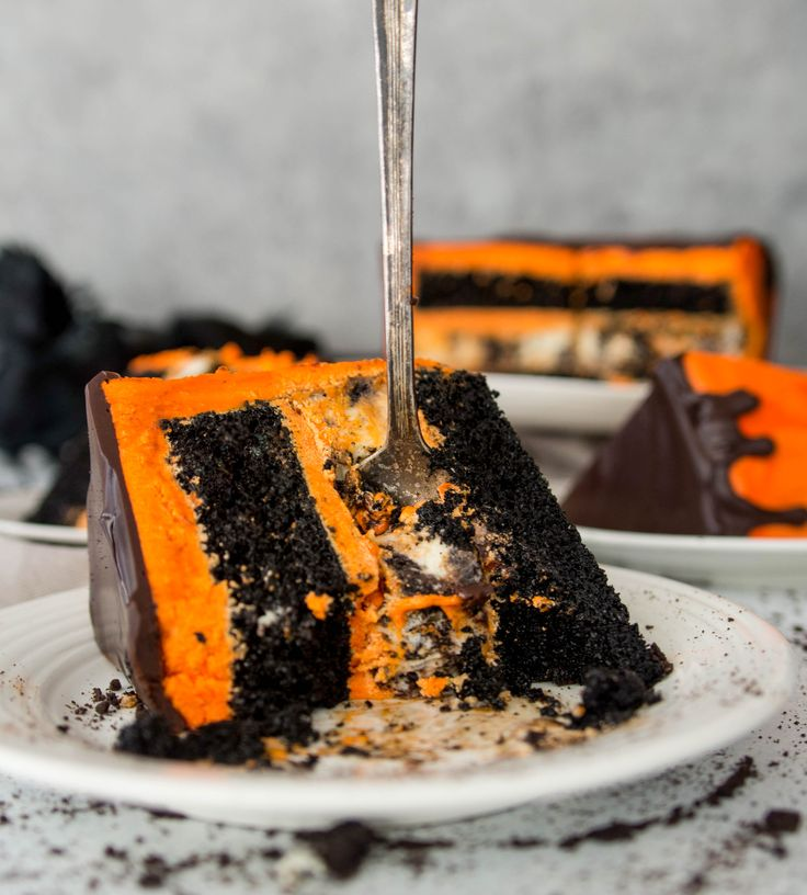 Black velvet cookies 'n cream cheesecake cake--it's the perfect dessert for your Halloween party, or for a regular old Monday night. #Halloween #cake #chocolate