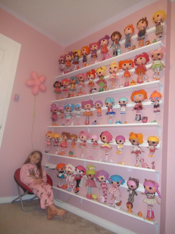 Sew clever! Lalaloopsy wall display. Finally a way to store these top heavy dolls!  And I thought my daughter had a lot of lala's, this girl has her beat by far!