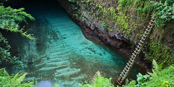 To Sua Ocean Trench, Lalomanu, Samoa   To Sua Ocean Trench is one of the idyllic sites located in Lotofaga village. A ladder is installed on site for visitors to access the water 30 metres down.