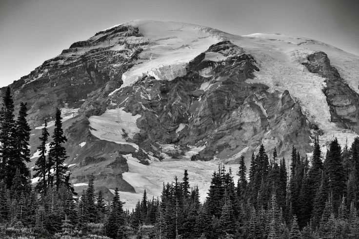 https://flic.kr/p/Qb6QvX | Mount Rainier in the Early Evening Hours (Black & White, Mount Rainier National Park) | That September evening was to have a highlight with the lunar eclipse and the dark skies around this national park. In the meantime, I was savoring the views of the mountain with only clear and blues skies around. I played around with several images angles and views, trying to capture that setting of the mountain peak and that balance between a wide angle and a close in view…