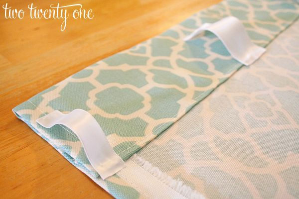 Ribbon hot glued on to sewn curtain panels for hanging on a rod. How to Make Curtains {DIY} - Two Twenty One
