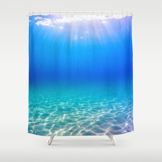 Underwater picture taken in Greece on a beautiful sandbeach with crystal clear water and the sun rays shining through the surface, creating a display of glowing patterns on the bottom. #underwater #water #sea #ocean #beach #summer #travel #adventure #blue #swimming #freediving #diving #homedecor #shower #bath #showercurtains #curtains
