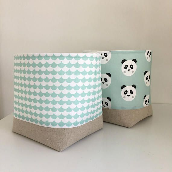 A very handy storage basket featuring adorable Panda faces.  The basket is in my new wider size meaning you can now store away even more of your clutter in style!  A lovely modern soft container, handy to have in any room and especially useful for keeping nappies and wipes in next to a babies changing table. Also great for storing small toys in, craft items, wool, make up etc. I even use one in our lounge to store my kids Wii controllers and headphones in!  Made with a cute, modern minty…