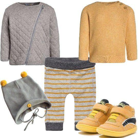 Giubbino grigio, effetto trapuntato con chiusura a cerniera, maglione con scollo tondo e dettaglio bottoni sulla spalla, pantaloni in fantasia a righe in giallo e grigio. Le sneakers della Primigi, di pelle e tessuto, adatte ai primi passi, cappello grigio con pompon gialli. Per le giornate più fresche, consigliamo di scegliere anche una t-shirt con manica lunga, magari mantenendo la nuance del giallo e sostituite il giubbino con un piumino, se il clima è ancora rigido.