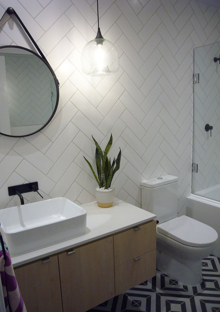 Review Interiors - Bathroom renovation. #reviewinteriors #yarravalley #pendantlighting #lighting #herringbonetiling #interiordesign #interiordesignmelbourne