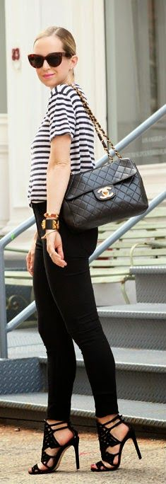 Gorgeous black tights jeans with top short sleeve stripes tee blouse and black leather hand bag and black stripes high heels sandals and goggles the best way to show fashion & style