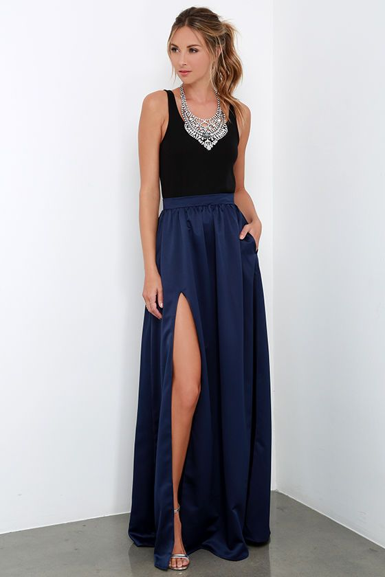 Poets and laureates alike will muse upon how lovely you look as you wander through the gardens in the 'Twas a Dream Navy Blue Maxi Skirt! Satiny woven fabric with a luxurious sheen falls from a high, fitted waist into a billowing maxi skirt with a sultry thigh high slit. Hidden zipper/hook closure at back.