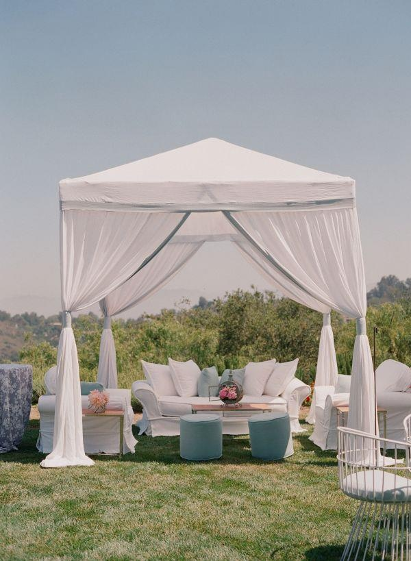 10x10 tent curtain idea -- use pink ribbons instead of silver to tie curtains around pole