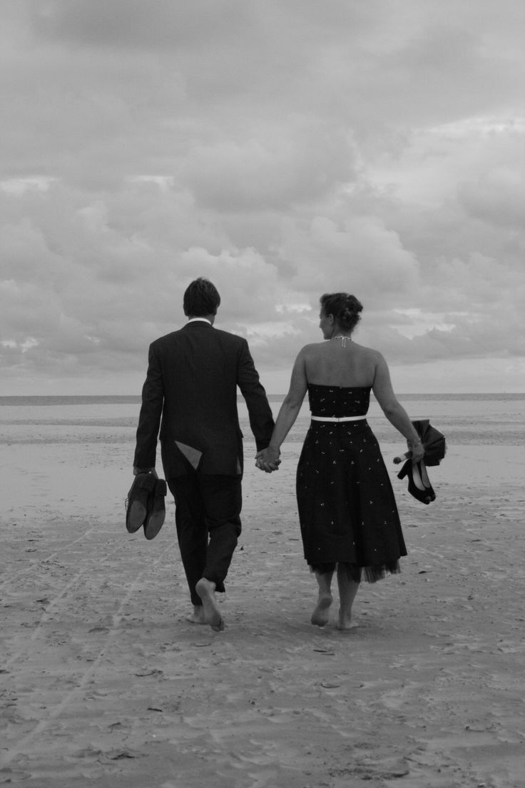 Just married! Walking on the beach of the island Terschelling, The Netherlands