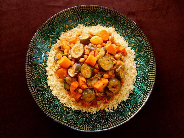 Make this sweet & spicy Moroccan-Style Vegetable Couscous as a festive vegan entree. Zucchini, sweet potatoes, chickpeas, dried fruit & spices.