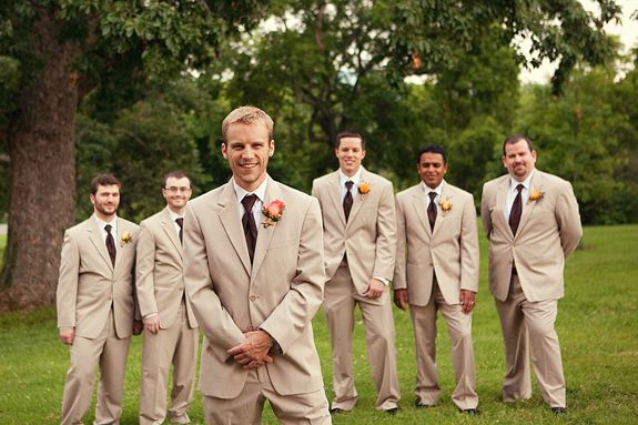 Beige tuxedos// use a dark blue for groom and lighter shade blue for wed party; groomsmen and bridesmaids. His dark blue will be brought our in my flowers and other bouqets