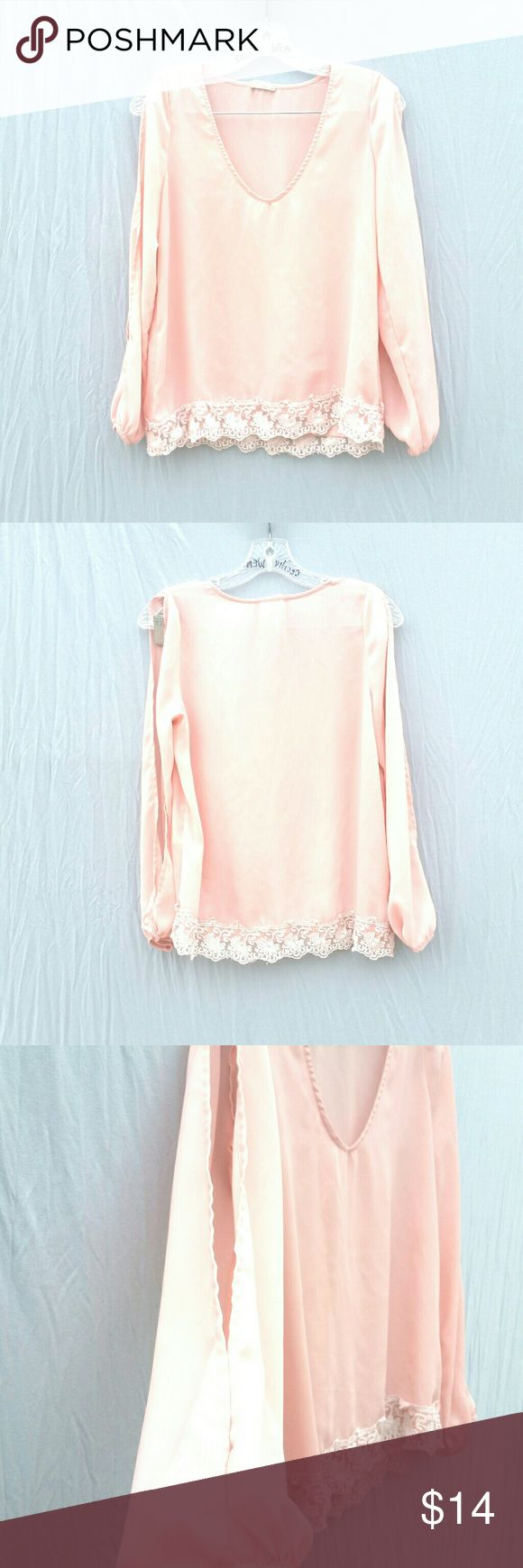 """TOBI pink chiffon slit sleeve blouse small Worn once light pink chiffon like blouse with white lace hem. Has slit sleeves and elastic at the wrists. V neckline. No major flaws or stains. Has some string fraying near one of the wrists but does not bother with wear. Just too big on my petite frame which is why I'm selling it.  Tag Size : Small  Length: 22"""" Loose fit.   #tothedunes pink lace hem chiffon lightweight hipster Boho floral festival summer cute spring casual date cut Sleeve bell slit…"""