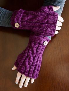 Free Knitting Pattern for Jammin' Fingerless Mitts - These mitts feature a simple & elegant twisted cable, with 2x2 ribbing all around, accented with a strap and button on the wrist. Aran yarn. Designed by Whittney Perez