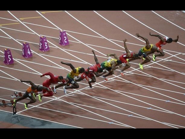 Aug 5, 2012; London, United Kingdom; Usain Bolt (JAM), Yohan Blake (JAM), and Justin Gatlin (USA), Tyson Gay (USA) and Ryan Bailey (USA) start in the men's 100m final during the London 2012 Olympic Games at Olympic Stadium. Mandatory Credit: Richard Mackson-USA TODAY Sports