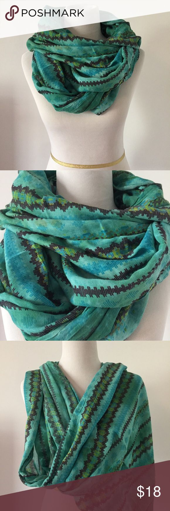 Urban Outfitters Turquoise Infinity Scarf Turquoise Infinity Scarf by Silence and Noise at Urban Outfitters. In excellent condition. Finished with beautiful Aztec Tribal Print Detailing. No visible signs of wear or use. No rips, stains, or fading. Made out of a light weight soft breathable fabric. An awesome accent for any outfit. Please feel free to ask any questions :) Urban Outfitters Accessories Scarves & Wraps