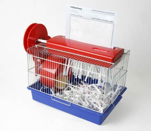 It's a hamster powered paper shredder! The hamster runs on the wheel, shredding the paper that then becomes its bedding. Ingenious!Paper Shredder, Hamsters Cages, Hamsters Shredder, Power Paper, Awesome Inventions, Crazy Inventions, Products, Hamsters Power, Hamster Cages