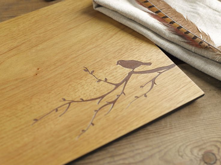 Denby Lifestyle. These wooden placemats and coasters feature a beautiful bird on a branch silhouette etched into the surface. They are perfect for any table and also complement Heritage tableware.