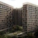 Emplazado en Barrio Junior, uno de los más tradicionales de la ciudad, el conjunto se define como un complejo autosuficiente que se organiza a partir de cinco torres exentas y algunos bloques bajos en tiras, vinculados todos a través de espacios verdes